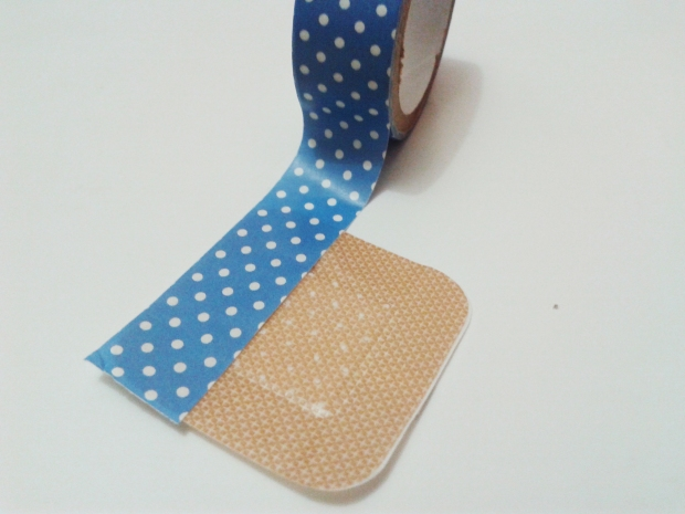 Carefully tape the washi tape on the band-aid.