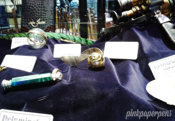 The Golden Snitch along with other memorable tiny props.